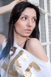 Beautiful woman portrait. Young beautiful woman portrait near window Stock Photography