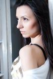 Beautiful woman portrait. Young beautiful woman portrait near window looking outside Stock Image