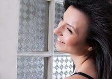 Beautiful woman portrait. Happy young beautiful woman portrait near window, smiling Royalty Free Stock Photography