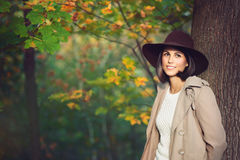 Beautiful woman portrait among autumn colors Stock Photography