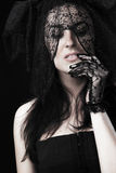 Beautiful woman portrait in black dress and voile. And gloves Royalty Free Stock Photo