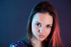 Beautiful woman portrait in blue and red light Royalty Free Stock Photo