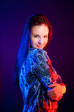 Beautiful woman portrait in blue and red light Stock Images