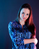 Beautiful woman portrait in blue and red light. Royalty Free Stock Images