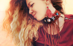 Beautiful woman portrait with boho necklace and earrings with re Stock Photos