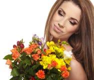Woman portrait  with bouquet Stock Image