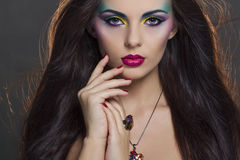Beautiful woman portrait with bright colourful makeup Stock Image