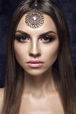 Beautiful woman portrait in east style with jewelry. Beautiful woman portrait in east style with jewelry on forehead Stock Photography