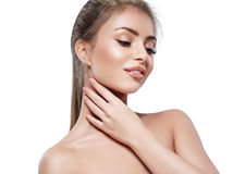 Beautiful woman portrait face with beautiful blond hair studio isolated on white. Touching her neck by hand. Royalty Free Stock Images