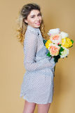 Beautiful woman portrait with flowers bouquet Stock Photos