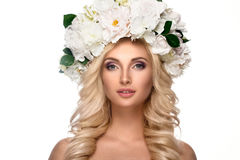 Beautiful woman portrait with flowers on head. And curly hair Stock Photos