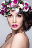 Beautiful woman portrait with flowers on head. And pink lipstick Royalty Free Stock Image