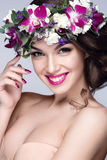 Beautiful woman portrait with flowers on head. And pink lipstick Royalty Free Stock Photo