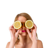 A beautiful woman portrait with fresh lemon. Stock Photos