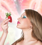 A beautiful woman portrait with fresh strawberry. Stock Photos