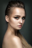 Beautiful woman portrait on grey background. With green eye shadows Royalty Free Stock Photo
