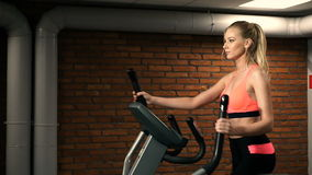 Beautiful woman portrait at the gym cycling stock footage
