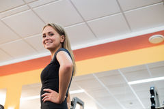 Beautiful woman portrait at the gym smiling Royalty Free Stock Photos