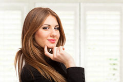 Beautiful woman portrait in her office Stock Photography