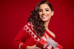 Beautiful woman portrait hold gift Stock Photo