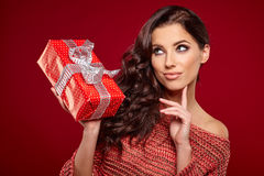 Beautiful woman portrait hold gift Royalty Free Stock Photos