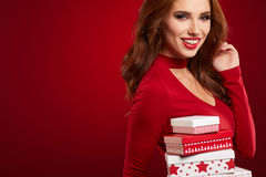 Beautiful woman portrait hold gift in christmas color style . Stock Photos