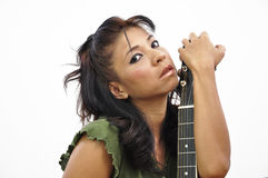 Beautiful woman portrait holding guitar close to her face Stock Photos