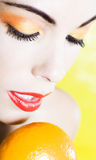 Beautiful Woman Portrait holding a mandarin Royalty Free Stock Photos