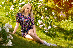 Beautiful woman portrait in lilac tree flowers Royalty Free Stock Images