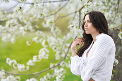 Beautiful woman portrait looking away in the meadow Royalty Free Stock Image