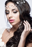 Beautiful woman portrait with nice makeup and white jewelry. Bride Stock Image