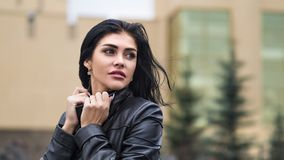 Beautiful woman portrait outdoor in autumn windy day. royalty free stock image