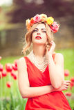 Beautiful woman portrait outdoor with colorful flowers Stock Photos