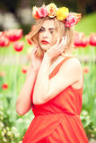 Beautiful woman portrait outdoor with colorful flowers Royalty Free Stock Photo