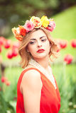 Beautiful woman portrait outdoor with colorful flowers Royalty Free Stock Images