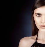 Beautiful woman portrait perfect make up on dark background Stock Photo