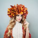 Beautiful woman portrait. Perfect model in autumn leaves crown.  royalty free stock photos