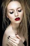 Beautiful woman portrait with red lips. And glamour make up Stock Images