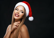 Beautiful woman portrait with Santa's hat, on dark background royalty free stock photos