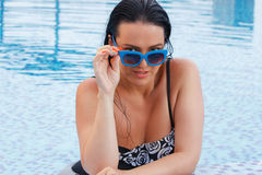 Beautiful woman portrait in swimming pool Royalty Free Stock Photo