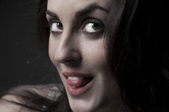 Beautiful  woman portrait with tongue Stock Photography