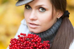 Beautiful woman portrait with viburnum berries Stock Images