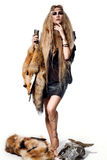 Beautiful woman portrait in wild style with fur and leather clothes. Amazon Stock Image
