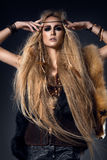 Beautiful woman portrait in wild style with fur and leather clothes. Amazon Royalty Free Stock Photography