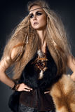 Beautiful woman portrait in wild style with fur and leather clothes. Amazon Stock Photography