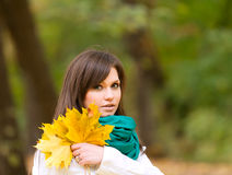 Beautiful woman portrait with yellow leaf Royalty Free Stock Images