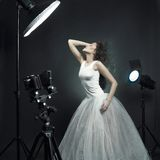 Beautiful woman pose in photo-studio. Beautiful young woman in white dress pose in photo-studio stock photos