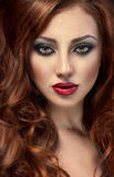 Beautiful woman with posh red hair Stock Photo