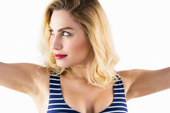 Beautiful woman posing with arms outstretched against white background Royalty Free Stock Images