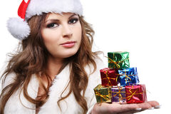 Beautiful woman posing as Santa Claus. Isolated. Stock Photo